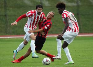 Un'azione di gioco: Marinucci Palermo tra Romano e Kouko (foto www.cronachemaceratesi.it)