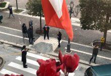 Photo of Covid-19, a Palazzo San Giorgio bandiere a mezz'asta e minuto di raccoglimento